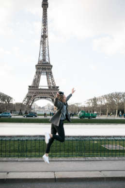 Photo of Stephanie Tusler in front of the Eiffel Tower in Paris, France
