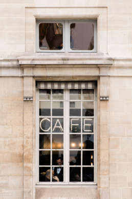 Photo of a cafe window in Paris, France