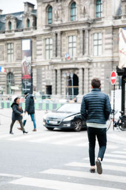 Photo of a man walking the streets of Paris, France