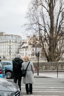Photo of couple embracing in the streets of Paris, France