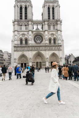 Photo of Stephanie Tusler in front of the Notre Dame in Paris, France